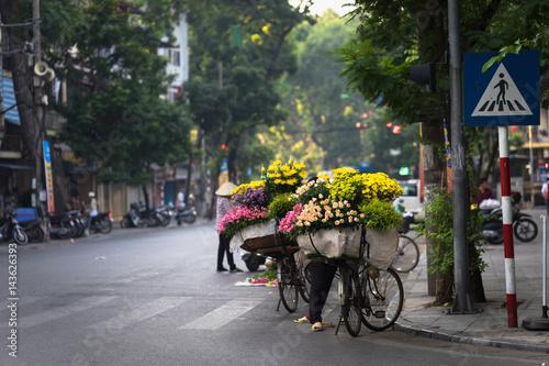 Fototapeta Hanoi street with flower vendors obraz na płótnie