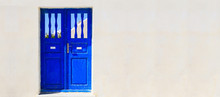 Blue Door On A Whitewashed Wal...