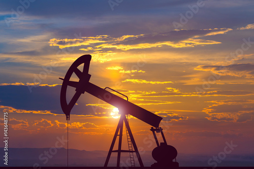 The oil pump on the background of the sunset Wallpaper Mural