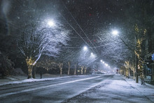 Snowy Road At Night In Downtow...