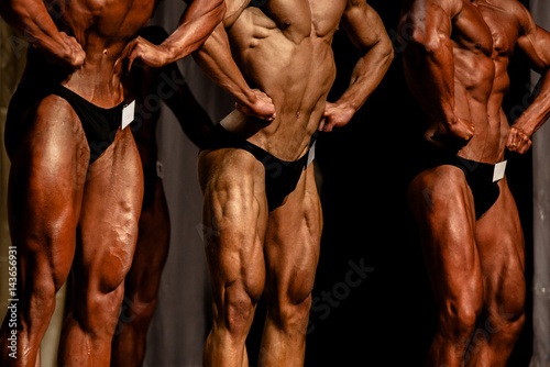 Fototapeta athlete bodybuilder abdominal thigh pose bodybuilding competitions obraz