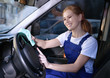 Woman with rag cleaning steering wheel