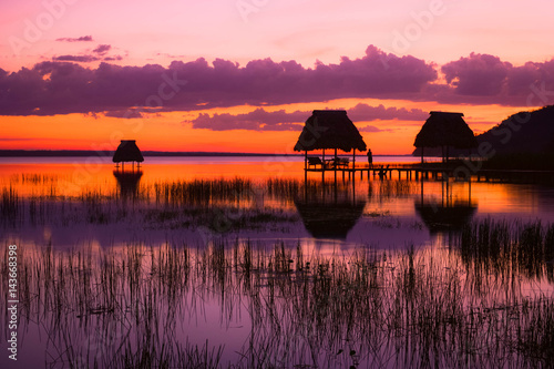 Foto op Plexiglas Crimson Last minutes of sunset at the lake Peten Itza in El Ramate, Guatemala. Central America