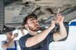 Experienced mechanics working in a car repair shop