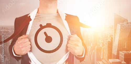 Foto  Midsection of businessman opening shirt in superhero style