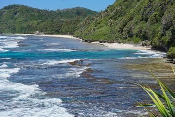 Coast of the island of Rurutu with beach and rocky seashore, French Polynesia, Austal archipelago, south Pacific ocean