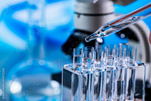 Fototapeta Science laboratory research and development concept. microscope with test tubes obraz