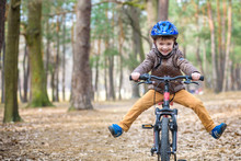 Happy Kid Boy Of 3 Or 5 Years Having Fun In Autumn Forest With A Bicycle On Beautiful Fall Day. Active Child Wearing Bike Helmet. Safety, Sports, Leisure With Kids Concept.