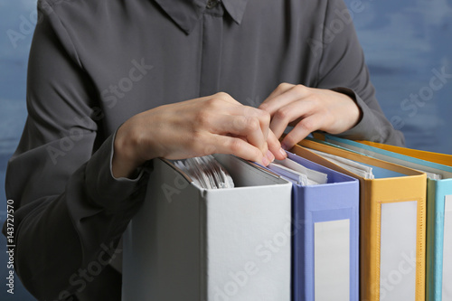 Fototapety, obrazy: Closeup view of woman with document folders