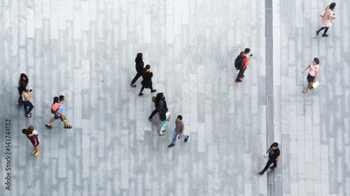 Valokuva  people walk on across the pedestrian concrete landscape in the city street (Aeri