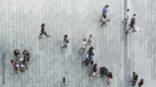 people walk on the pedestrian street walkway with the teenage young man and the group of family with little child Canvas-taulu