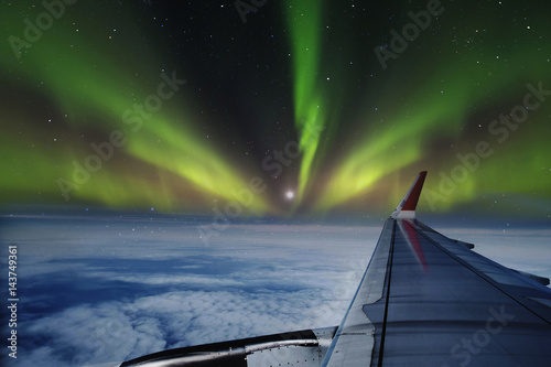 Photo sur Aluminium Aurore polaire Aerial view of Northern Lights (Aurora Borealis) from window of an flying airplane