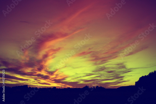 Montage in der Fensternische Hochrote Rural landscape after sunset. Silhouette of village against colorful sunset sky