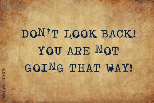 Inspiring motivation quote of don't look back you are not going that way with typewriter text Tapéta, Fotótapéta
