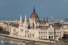 Cityscape Of Budapest With Hungarian Parliament Building On Danube River Seen From The Buda Side On A Sunny Day