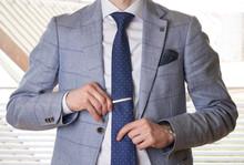 Unrecognizable Businessman Setting The Tie Straight