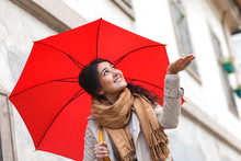 Portrait Of Beautiful Woman With Red Umbrella