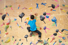 Young Boy Bouldering