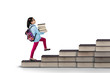 Little student holding pile of books in studio