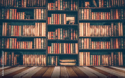 blurred Image many old books on bookshelf in library Wallpaper Mural