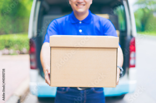 Delivery concept - Smiling happy young asian handsome male