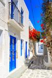 Fototapeta Fototapety na drzwi - Traditional greek houses with spring flowers on Paros island. Cyclades. Greece.