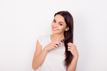 Happy Young Woman Combing Her Long Healthy Hair On White Background