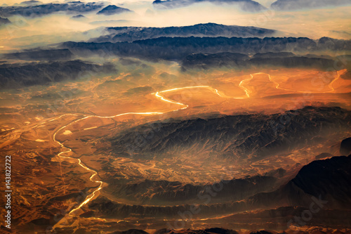 Deurstickers Luchtfoto Aerial view from air plane of desert mountains