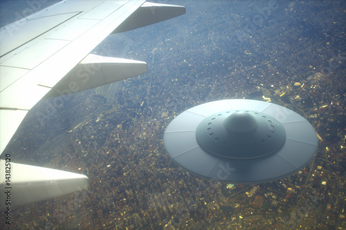 Foto op Canvas UFO UFO - Unidentified Flying Object. Alien spaceship flying together with airplane.