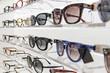 Leinwanddruck Bild - Sunglasses and eye glasses in a store.