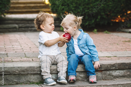 Fotografie, Obraz  Group portrait of two white Caucasian cute adorable funny children toddlers sitt