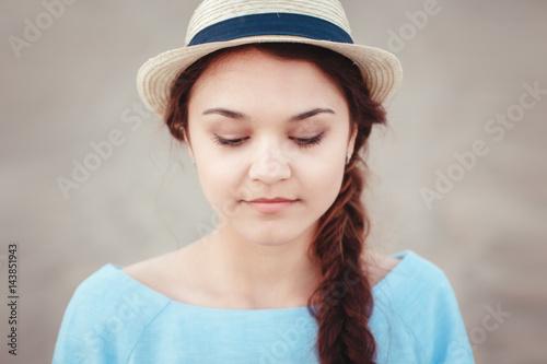 Closeup portrait of beautiful pensive white Caucasian brunette girl with plait i Canvas-taulu
