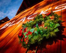 Christmas Wreath On Old Blacksmith's Barn