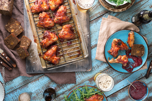 In de dag Grill / Barbecue Dinner table with chicken wings and beer, rustic style