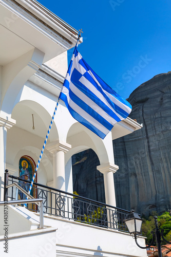 Staande foto Tunesië White and blue greek flag and white wall of the church