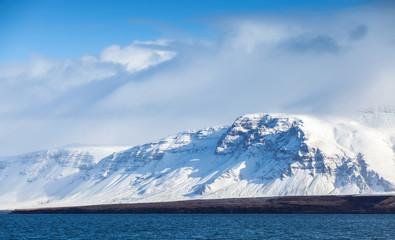 Fototapeta na wymiar Icelandic landscape with snowy mountains and sky