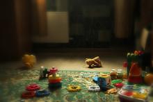 Teddy Bear Lying On The Floor. Discarded Abandoned Bear Cub. Scattered Toys