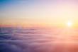 Leinwandbild Motiv Sunset clouds from above