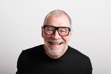 Senior Man In Black T-shirt And Eyeglasses, Studio Shot.