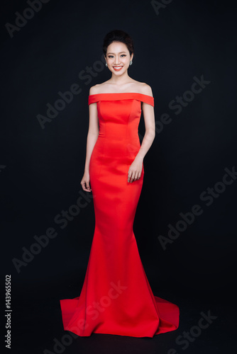 Asian Woman With Fashion Makeup In Luxury Red Dress