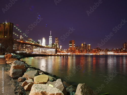 Brooklyn bridge and lower Manhattan skyline at night view from DUMBO Poster
