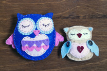 Couple Of Felt Owls On A Wooden Background