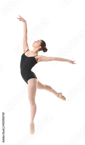 Photo  Young beautiful ballerina dancing on white background