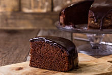 Slice Of Homemade Chocolate Cake On Wooden Table