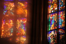 Reflection Of Stained Glass On The Wall