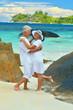 Happy cute elderly couple at sea