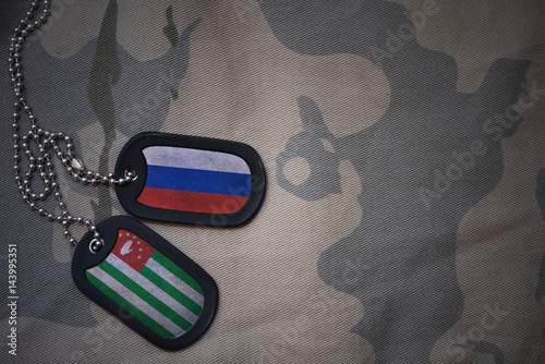 army blank, dog tag with flag of russia and abkhazia on the khaki texture background Wallpaper Mural