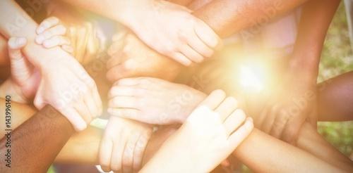Fotografía  Friends putting their hands together