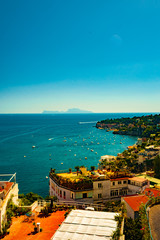 FototapetaNaples bay scenic view, Italy. Travel background picture with blue sea and cityscape in golden light of evening.