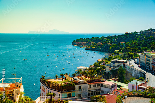 Foto op Plexiglas Napels Naples bay scenic view, Italy. Travel background picture with blue sea and cityscape in golden light of evening.